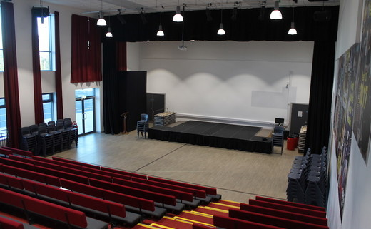 Regular_dchs_main_hall_seating_and_stage
